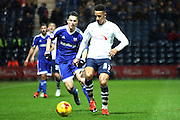 Callum Robinson and Brentford Midfielder Sergi Canos battle during the Sky Bet Championship match between Preston North End and Brentford at Deepdale, Preston, England on 23 January 2016. Photo by Pete Burns.
