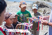 Boys from Boquillas del Carmen line the banks of the Rio Grande River to sell souvenirs to tourists from Big Bend National Park on May 15, 2014.