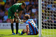Remi Matthews helps Scunthorpe's Scott Wiseman to his feet during the Sky Bet League 1 match between Burton Albion and Scunthorpe United at the Pirelli Stadium, Burton upon Trent, England on 8 August 2015. Photo by Aaron Lupton.