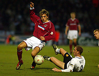 Photo: Scott Heavey.<br /> Northampton Town v Manchester United. FA Cup Fourth Round. 25/01/2004.<br /> Nicky Butt slides in on Martin Reeves (L)
