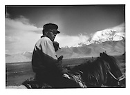 Kyrgyz Muslim horsemen at 3,600m (11,800ft), on the Karakorum Highway, Chinese Turkestan.  Armies have traversed this trade route for millennia which connects the great civilizations of the  Indian Subcontinent (and now Pakistan), and Afghanistan to China.  Buddhism made its way to China, Korea and Japan along this route.  Marco Polo once travelled this route.  The Chinese used to call this spot the journey through the greater and lesser headache mountains for the Pamir Mountains (seen) and the Karakorum Mountains which lay ahead.