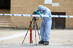 © Licensed to London News Pictures. 28/05/2019. London, UK.A forensic officer on Romford Road, Forest Gate, East London where a man in his 30s died in the early hours of this morning following a flight on Warwick Road.<br />