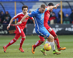Marcus Maddison of Peterborough United in action with Louis Thompson of Swindon Town. - Mandatory byline: Joe Dent/JMP - 27/02/2016 - FOOTBALL - ABAX Stadium - Peterborough, England - Peterborough United v Swindon Town - Sky Bet Championship