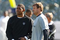 Nov 6, 2011; Oakland, CA, USA; Oakland Raiders quarterback Terrelle Pryor (left) and quarterback Carson Palmer (right) warm up before the game against the Denver Broncos at O.co Coliseum. Denver defeated Oakland 38-24. Mandatory Credit: Jason O. Watson-US PRESSWIRE