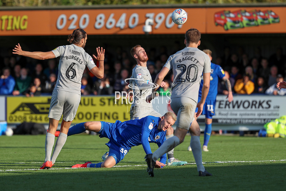 AFC Wimbledon striker Joe Pigott (39) fouled just outside the box during the EFL Sky Bet League 1 match between AFC Wimbledon and Portsmouth at the Cherry Red Records Stadium, Kingston, England on 19 October 2019.