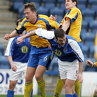 Queen of the South v St Johnstone..30.04.05<br />Jim Thomson in a challenge with Ian Maxwell and Sean Webb<br /><br />Picture by Graeme Hart.<br />Copyright Perthshire Picture Agency<br />Tel: 01738 623350  Mobile: 07990 594431