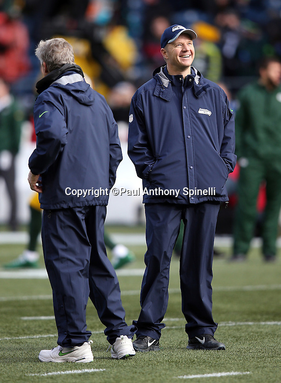 Seattle Seahawks offensive coordinator Darrell Bevell smiles as the sun comes out for pregame warmups before the NFL week 20 NFC Championship football game against the Green Bay Packers on Sunday, Jan. 18, 2015 in Seattle. The Seahawks won the game 28-22 in overtime. ©Paul Anthony Spinelli