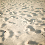Footprints in the white sand of the beach of Playa Mujeres on Mexico's Caribbean coast.