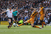 Hull defender Michael Dawson wins the ball during the Sky Bet Championship play-off first leg match between Derby County and Hull City at the iPro Stadium, Derby, England on 14 May 2016. Photo by Aaron  Lupton.