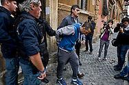 Roma 4  Novembre 2013<br /> Sgomberato uno stabile in Via Giusti, al quartiere Esquilino , occupato dai movimenti di lotta per la casa lo scorso 13 ottobre, 20 le persone indentificate e 2  portate via in manette, sono state lanciate suppellettili e mobilio dalle finestre  per  resistere allo sgombero contro la polizia. Uno dei due  fermati portato via dalla polizia<br /> Rome, 4 November 2013<br /> Eviction  a building  in Via Giusti, the Esquilino district , occupied by the movements of struggle for the house last October 13, 20 people identified, two taken away in handcuffs, furnishings and furniture were thrown from the windows to resist the eviction against the police. One of the two suspects taken away by police