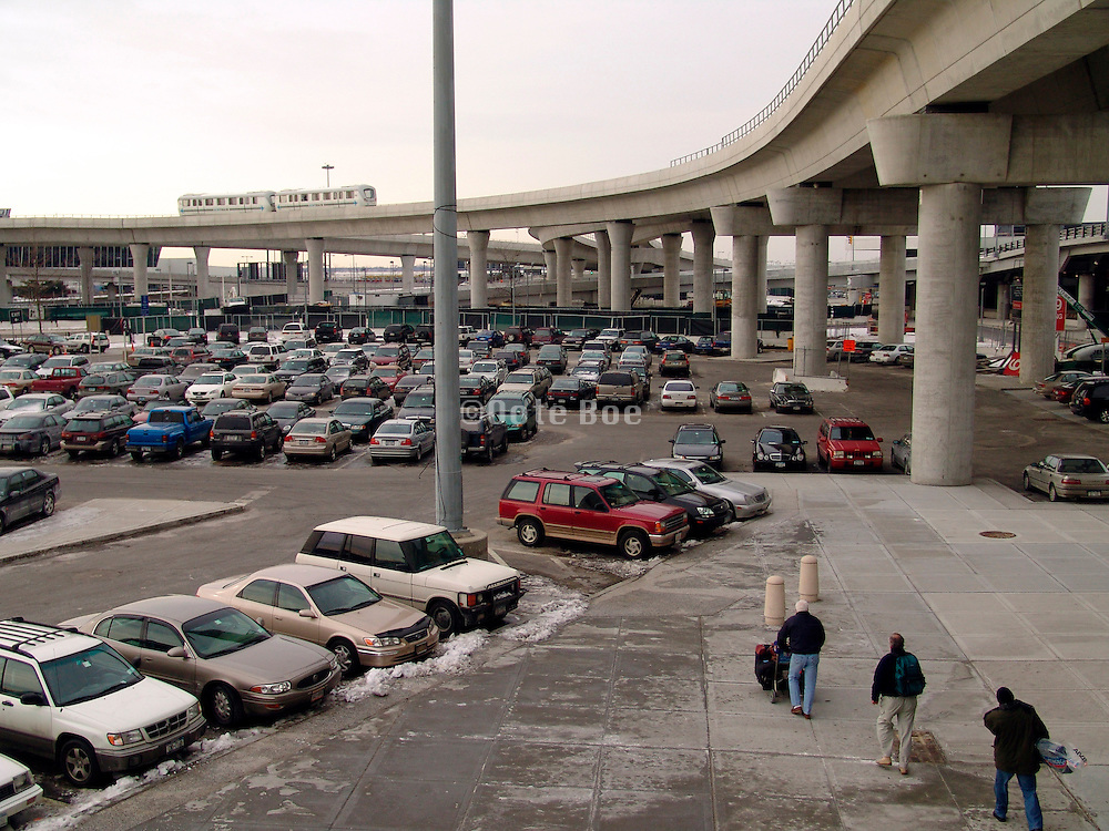 Car parking lot under a new elevated railroad track.