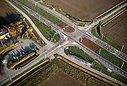 Nederland, Zeeland, Noord-Beveland, Oud-Noord-Beveland polder, 15/11/2001; provinciale weg N 256 (rechts beneden naar linksboven) naar Zeelandbrug, voormalige tol, kruist secondaire weg; structuur wegen en landschap, kruising, vluchtheuvels, luchtfoto (toeslag), aerial photo (additional fee)<br /> photo/foto Siebe Swart