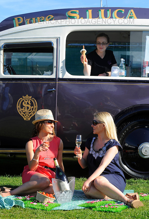 Anjali Potter (pink dress) and Clare Hawkins (blue dress) enjoy sun, Champaign and ice cream at the Taste of Edinburgh event at Inverleith Park.  Pictured top Lynn Hryhorskyj sells ice cream from a vintage S Lucas Ice Cream Van.