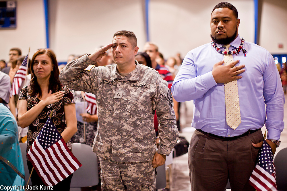 """July 2 - PHOENIX, AZ: Arizona Cardinals' offensive lineman TAITUSI """"Duece"""" LATUI,   originally from Tonga, RIGHT, and others are sworn as US citizens Friday. Nearly 200 people were sworn in as US citizens during the """"Fiesta of Independence"""" at South Mountain Community College in Phoenix, AZ, Friday. The ceremony is an annual event on th 4th of July weekend and usually the largest naturalization ceremony of the year in the Phoenix area.  Photo by Jack Kurtz"""