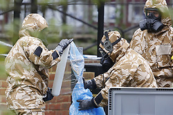 © Licensed to London News Pictures. 24/04/2018. Salisbury, UK. Members of the armed forces wrap a spade as they clean up the area of the Maltings where a bench was earlier removed in Salisbury. Former Russian Spy Sergei Skripal and his daughter Yulia were poisoned using a nerve agent in the city last month. Experts have warned that 'Toxic levels' of the nerve agent novichok could still be present at hot spots around the city. Photo credit: Peter Macdiarmid/LNP