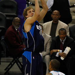 Mar 22, 2010; New Orleans, LA, USA; Dallas Mavericks forward Dirk Nowitzki (41) shoots over New Orleans Hornets forward David West (30) during the first half at the New Orleans Arena. Mandatory Credit: Derick E. Hingle-US PRESSWIRE