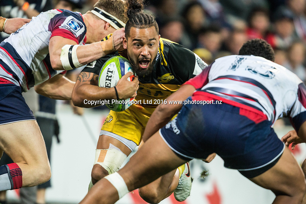 Matt Proctor makes an expression as he gets tackled during the round 8 Super Rugby match between the Melbourne Rebels VS The Hurricanes at AAMI park Melbourne Australia. Friday 15th April 2016. Copyright Photo. Brendon Ratnayake / www.photosport.nz