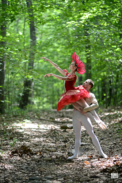 Connecticut Ballet male dancer holding in the air a female dancer, dressed up as a fairy within a magical enchanted forest.