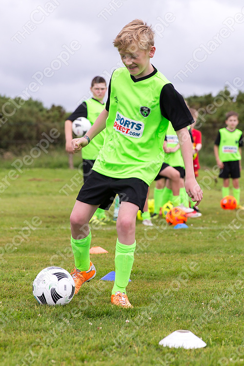 Brian McArdle from Inch going through some soccer drills at the FAI Soccer Summer camp in Kilmaley