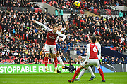 Arsenal Defender Nacho Monreal (18) and Tottenham Hotspur Defender Jan Vertonghen (5) battle for the ball during the Premier League match between Tottenham Hotspur and Arsenal at Wembley Stadium, London, England on 10 February 2018. Picture by Stephen Wright.