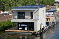 NLD, the Netherlands, Maastricht, Autarkhome, floating house on the banks of the river Meuse. The Autarkhome is the first self-sufficient floating passive house in the world. It needs no connections on the banks. It was designed by Pieter de Kromwijk from Coenegracht en Kromwijk  architects. This model house is furnished by IKEA. - ..NLD, Niederlande, Maastricht, Autarkhome, schwimmendes Haus am Ufer der Maas. Das Autarkhome ist das erste schwimmende Passivhaus der Welt. Das Haus ist komplett selbstversorgend und braucht keine Anschluesse auf dem Ufer. Der Entwurf stammt von Pieter Kromwijk von Coenegracht en Kromwijk Architekten. Diese Musterhaus wurde von IKEA ausgestattet.