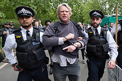 © Licensed to London News Pictures. 16/05/2020. London, UK. A protester is arrested by policemen after taking part in an illegal protest in Hyde Park organised by the UK Freedom Movement.  The demonstration took place during the Covid-19, is against the Coronavirus Bill and no to mandatory vaccines. Photo credit: London News Pictures