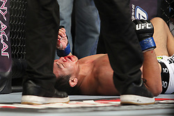 August 27, 2011; Rio De Janiero, Brazil;  Yushin Okami (white trunks) lays on the canvas after being knocked out in his UFC Middleweight Championship bout against Anderson Silva at UFC 134 in Rio De Janiero.