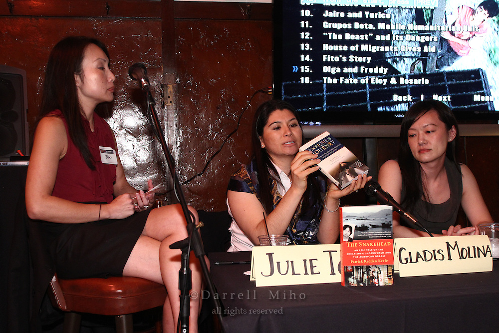 "Sep. 08, 2010; Los Angeles, CA - Gladis Molina holds up a copy of the book ""Enrique's Journey"" during the KIND: Kids In Need of Defense panel discussion and mixer at the Far Bar in Little Tokyo. ..photo credit: Darrell Miho..(L to R).Moderator: Julie To, Staff Attorney, CA Dept of Real Estate.Panelists:.Gladis Molina, KIND Pro Bono Attorney Coordinator - Los Angeles.Stacey Wang, Associate, Holland & Knight LLP"