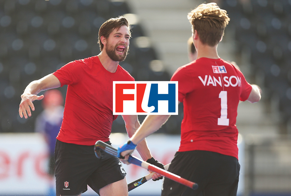 LONDON, ENGLAND - JUNE 16:  Iain Smythe of Canada celebrates as he scores their second goal with Foris Van Son (1) during the Hero Hockey World League Semi-Final Pool B match between Pakistan and Canada at Lee Valley Hockey and Tennis Centre on June 16, 2017 in London, England.  (Photo by Alex Morton/Getty Images)