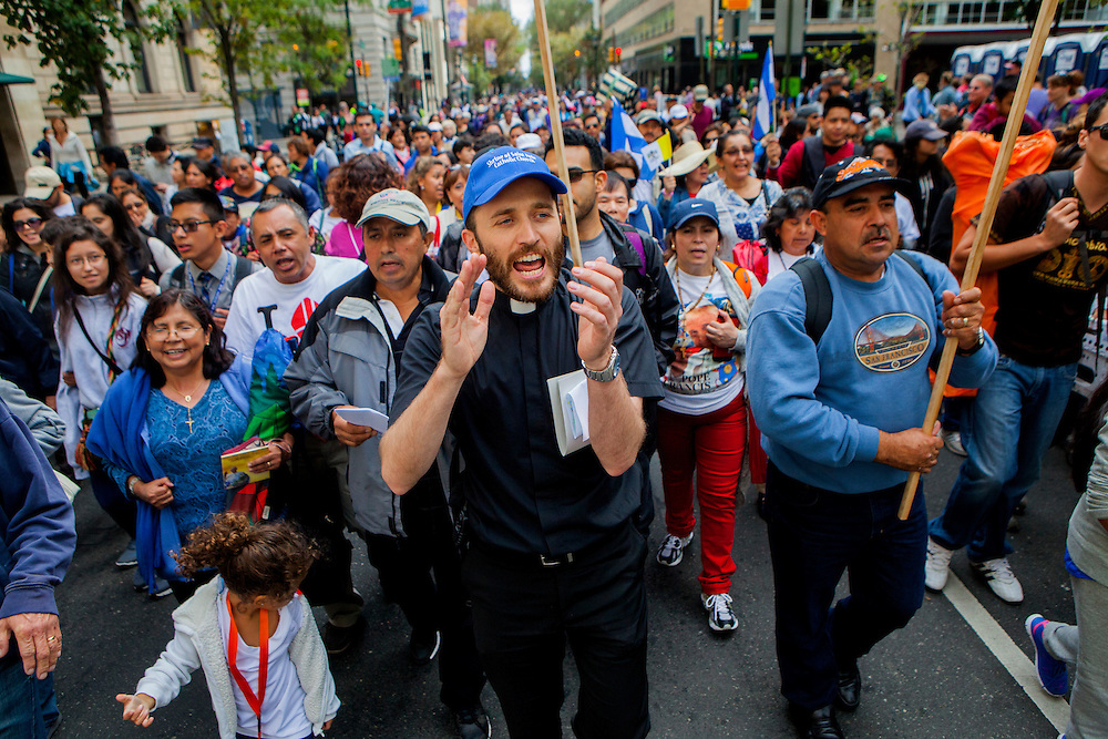 PHILADELPHIA, PA - SEPTEMBER 27, 2015: Father Daniele Rebeggiani from Shrine of St. Jude in Rockland, Maryland, leads a group in worship songs as they make their way to a Sunday Mass held by Pope Francis. CREDIT: Sam Hodgson for The New York Times