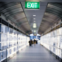 Blurred figures walking in an airport passageway