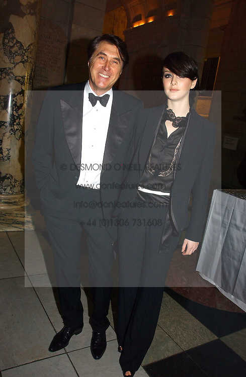 BRYAN FERRY and KATIE TURNER at the British Fashion Awards 2006 sponsored by Swarovski held at the V&A Museum, Cromwell Road, London SW7 on 2nd November 2006.<br />