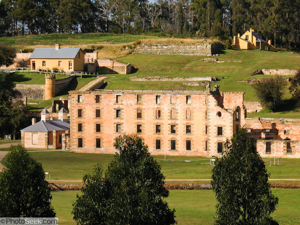 "Port Arthur is a small town and former English prison from 1830-1877 on the Tasman Peninsula, 60 km southeast of Hobart, state capital of Tasmania, Australia. Port Arthur is one of Australia's most significant heritage areas and the open air museum is Tasmania's top tourist attraction. Port Arthur Historic Site was honored in 2010 as part of the Australian Convict Sites on UNESCO's World Heritage List. Penal transportation to Australia from Britain/Ireland occurred 1787-1868 to rid overcrowded prisons of undesirables. In these difficult Dickensian times, inhumane death penalty laws of the ""Bloody Code"" were falling out of favor for minor offenses and small crimes, and prison populations were swelling in London."
