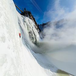 Jeff Mercier climbing Le Piler Direct at Chutes Montmorency in Quebec City, Quebec