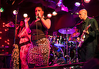 NEW ORLEANS - CIRCA FEBRUARY 2014: Music band performing and dancing in a nightclub during the Mardi Gras celebration in the French Quarter in New Orleans