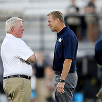 ORLANDO, FL - OCTOBER 09:  UCF head coach George O'Leary (L) speaks with BYU head coach Bronco Mendenhall at Bright House Networks Stadium on October 9, 2014 in Orlando, Florida. (Photo by Alex Menendez/Getty Images) *** Local Caption *** Bronco Mendenhall; George O'Leary