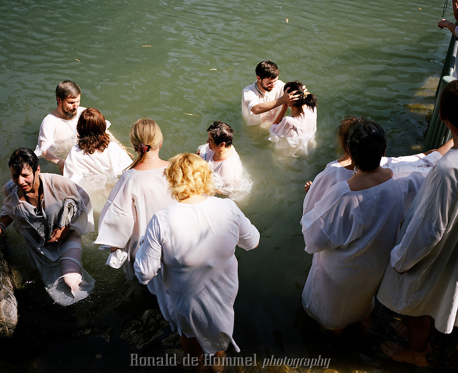 Yardenit baptism site attracts pilgrims from all over the world. It's said that Jesus was baptized in this area of the Jordan River, located on the few miles remaining as a natural river, between the Degania dam at the bottom of the Sea of Galilee and the Alumot dam. Israel.