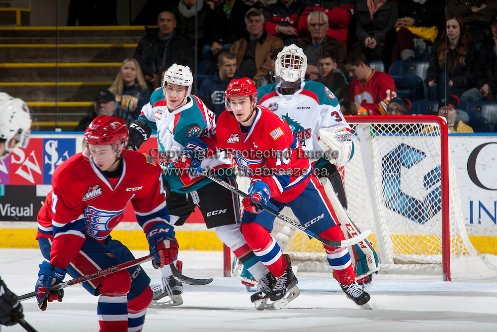 KELOWNA, CANADA - JANUARY 4: Ethan McIndoe #10 of the Spokane Chiefs checks James Hilsendager #2 in front of Michael Herringer #30 of the Kelowna Rockets during first period on January 4, 2017 at Prospera Place in Kelowna, British Columbia, Canada.  (Photo by Marissa Baecker/Shoot the Breeze)  *** Local Caption ***