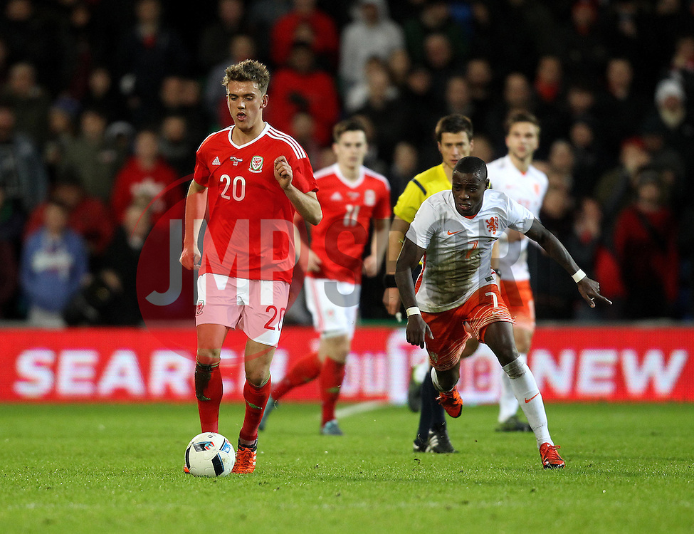 Emyr Huws of Wales is closed down by Quincy Promes of The Netherlands - Mandatory byline: Robbie Stephenson/JMP - 07966 386802 - 13/11/2015 - FOOTBALL - Cardiff City Stadium - Cardiff, Wales - Wales v Netherlands - International Friendly