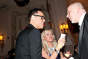 GOK WAN; ELLE G. LEWYS, Post Olivier Awards Gala party. Waldorf Astoria. London. 13 March 2011. -DO NOT ARCHIVE-© Copyright Photograph by Dafydd Jones. 248 Clapham Rd. London SW9 0PZ. Tel 0207 820 0771. www.dafjones.com.