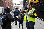 Brian Shaw, hanind out leaflets at the British Library picket line. PCS Budget Day Strikes were held all over London, followed by a rally outside the House of Commons. 20th March 2013.