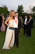 Catalina and Sir Elton John, Sir Elton John's White Tie and Tiara Ball. Windsor, 28 June 2003. © Copyright Photograph by Dafydd Jones 66 Stockwell Park Rd. London SW9 0DA Tel 020 7733 0108 www.dafjones.com