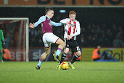 Aston Villa midfielder Jack Grealish (40) battles for possesion with Brentford midfielder Ryan Woods (15) during the EFL Sky Bet Championship match between Brentford and Aston Villa at Griffin Park, London, England on 31 January 2017. Photo by Matthew Redman.