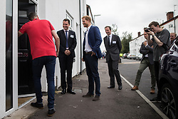 © Licensed to London News Pictures . 04/09/2017 . Manchester , UK . Prince Harry visits the Walking With the Wounded ( WWTW) hub on Canada Street , Newton Health .  WWTW helps ex-service personnel with physical or mental health needs make the transition back to civilian life . The street was subject to an episode of DIY SOS when people gave their time and resource to help redevelop the houses . Photo credit : Joel Goodman/LNP