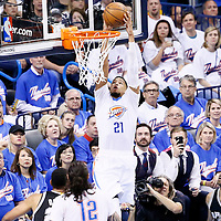 06 May 2016: Oklahoma City Thunder guard Andre Roberson (21) goes for the dunk during the San Antonio Spurs 100-96 victory over the Oklahoma City Thunder, during Game Three of the Western Conference Semifinals of the NBA Playoffs at the Chesapeake Energy Arena, Oklahoma City, Oklahoma, USA.