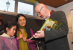 PJ Lynch signing books for some fans Eriko and Hazel Hopkinson during his visit to Westport Library as part of the Rolling Sun Festival...Pic Conor McKeown