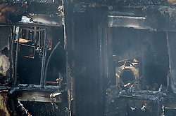 © Licensed to London News Pictures. 15/06/2017. London, UK. What appears to be a washing machine. The burnt out remains of the inside of some of the apartments can be seen the Grenfell tower block in west London. The blaze engulfed the 27-storey building with hundreds of firefighters attending the scene. Photo credit: Ben Cawthra/LNP