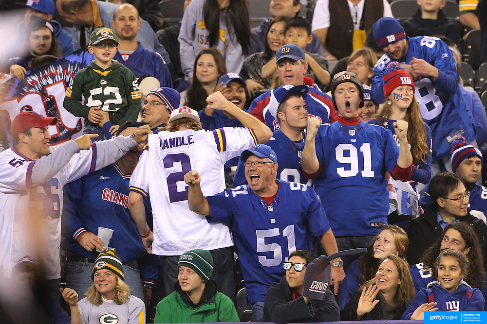 New York Giants fans celebrate a touchdown during the New York Giants Vs Green Bay Packers, NFL American Football match at MetLife Stadium, East Rutherford, New Jersey, USA. 17th November 2013. Photo Tim Clayton