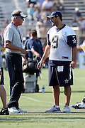 Dallas Cowboys quarterback Tony Romo (9) talks to Cowboys quarterbacks coach Wade Wilson during the second day of the Dallas Cowboys 2016 NFL training camp football practice held on Sunday, July 31, 2016 in Oxnard, Calif. (©Paul Anthony Spinelli)