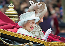 © London News Pictures. 05/06/2012. London, UK.  HM Queen Elizabeth II travels by coach with The Duchess of Cornwall down The Mall  to Buckingham palace without Prince Philip as part of the Diamond Jubilee Carriage procession on June 5, 2012.  Photo credit: Ben Cawthra/LNP